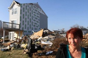 Susanne Bannon of Union Beach stands Monday where her townhouse stood before Sandy struck. / TANYA BREEN/STAFF PHOTOGRAPHER